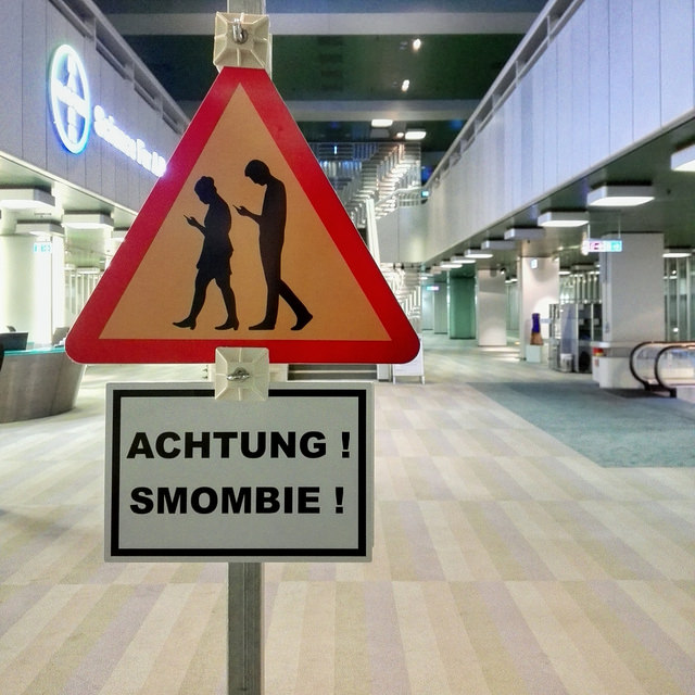 "A_Peach, ""Caution! Smombie!"", CC BY https://flic.kr/p/DAR8SC"